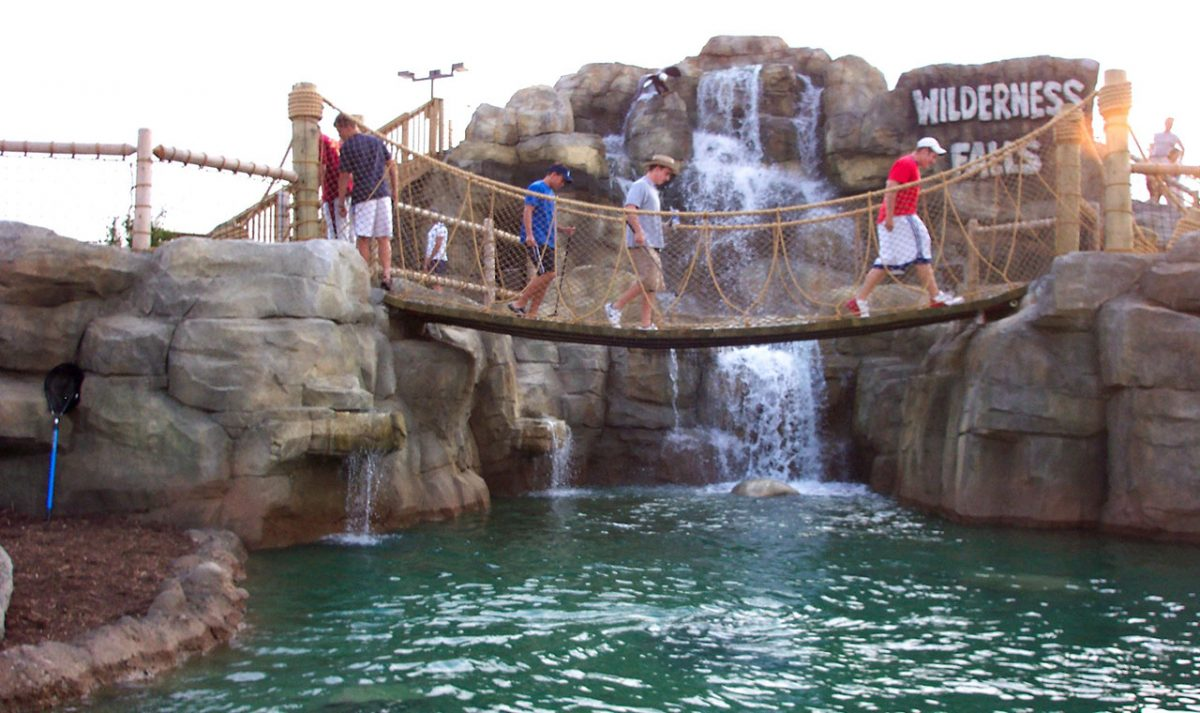 Adventure Golf Patrons Crossing Bridge Slide Photo